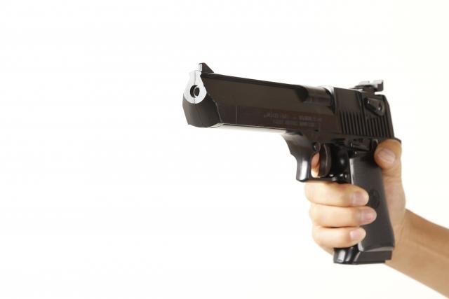 拳銃 犯人 吹田